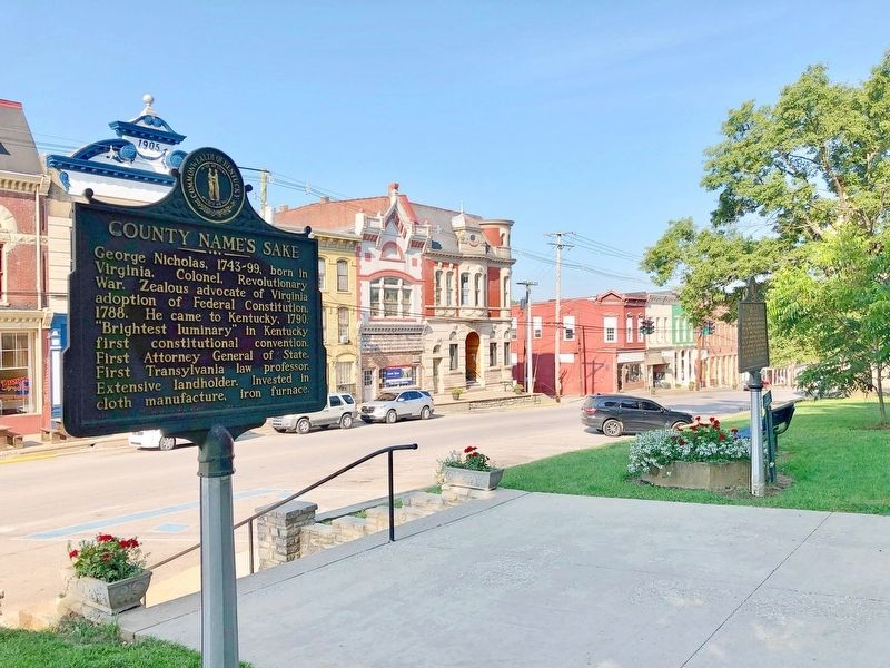 View of marker looking south at Main Street businesses. image. Click for full size.