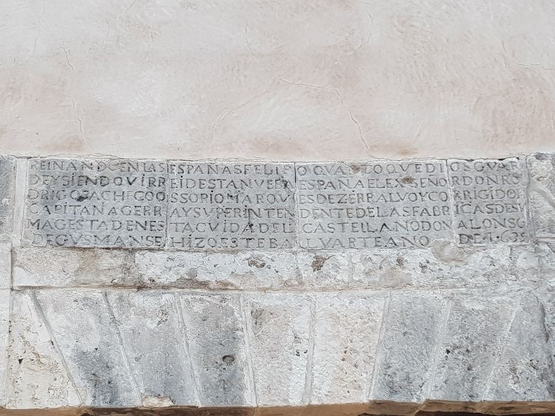 The Bastion of Santiago's 1635 dedicatory inscription over its entrance image. Click for full size.