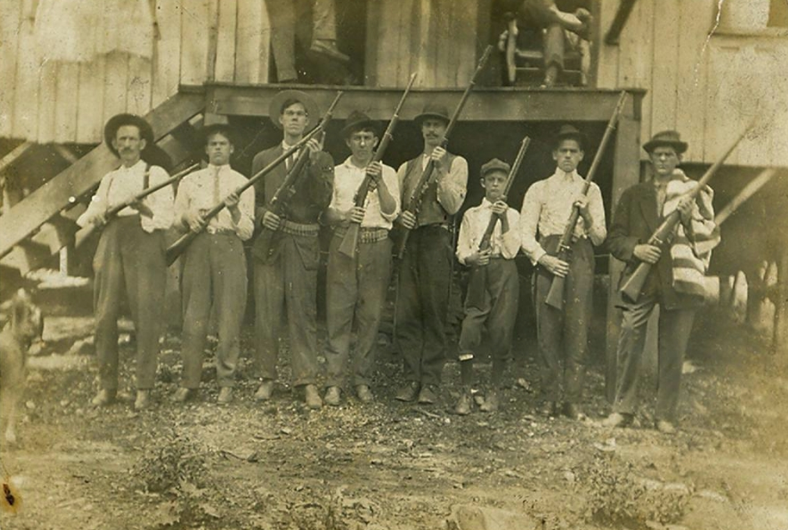 Miners posing with their guns in Eskdale WV
