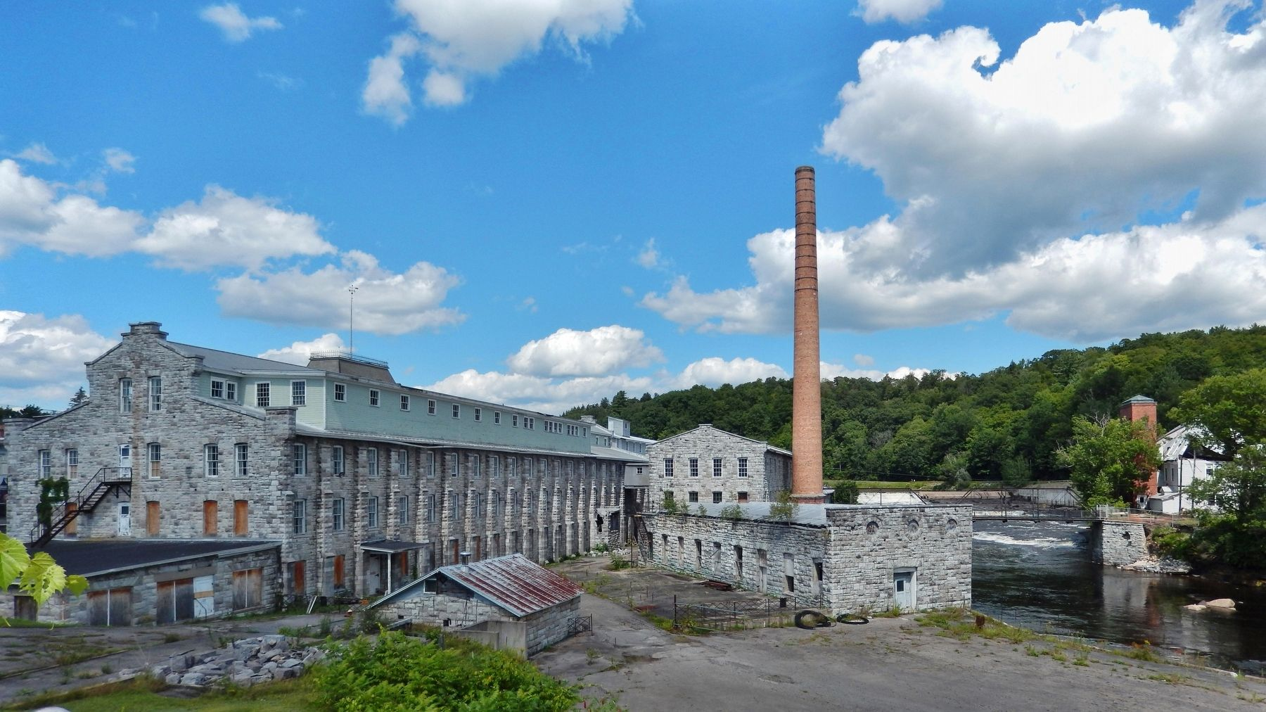 Dolge Company Factory Complex (<i>wide view from southwest • East Canada Creek on right</i>) image. Click for full size.