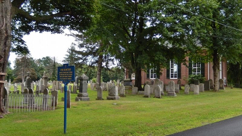1700 Cemetery Marker<br>(<i>wide view • cemetery & Brick Church in background</i>) image. Click for full size.