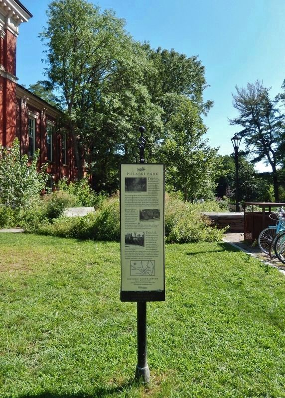 Pulaski Park Marker (<i>tall view • Pulaski Park in background • Memorial Hall on left</i>) image. Click for full size.