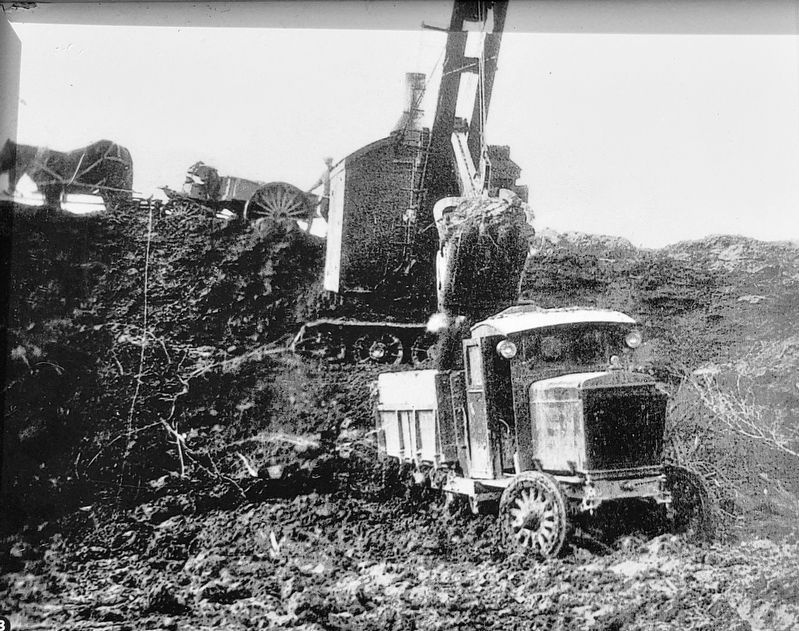 Marker detail: Steam shovel of Atlantic Gypsum loading truck in the quarry in Belle Marche • 1930 image. Click for full size.