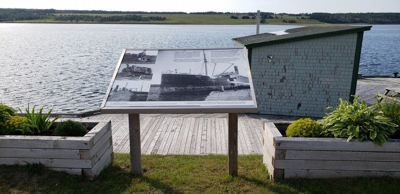 "Railroad and ""La Vieille Louise"" Marker<br>(<i>wide view looking west across Chéticamp Harbor</i>) image. Click for full size."