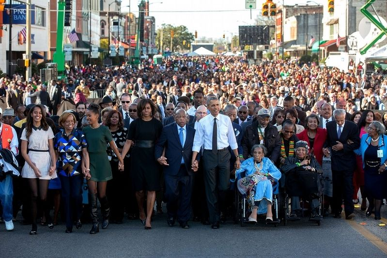 Amelia Boynton Robinson (in blue clothes in wheelchair) next to President Barack Obama. image. Click for full size.