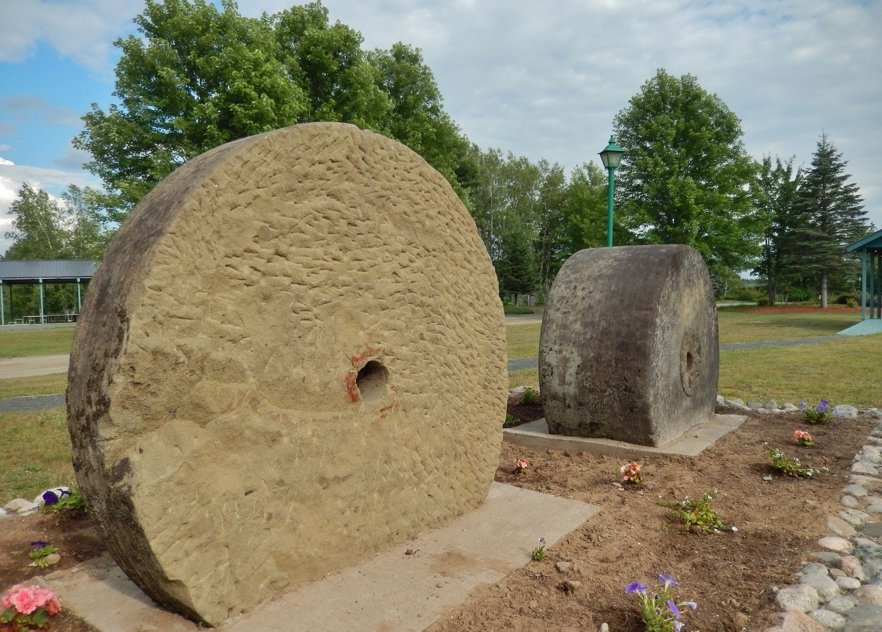 Millstones (<i>side view showing scoring and relative width</i>) image. Click for full size.
