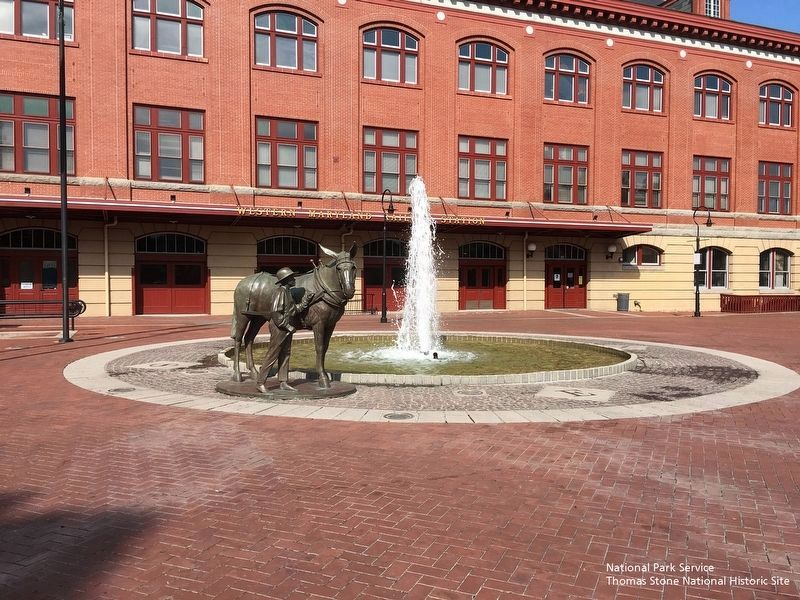 Mule and Handler Statue (foreground) and Western Maryland Train Station (background). image. Click for full size.