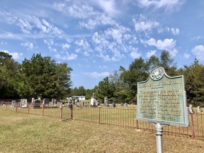 Marker with cemetery in background. image. Click for full size.