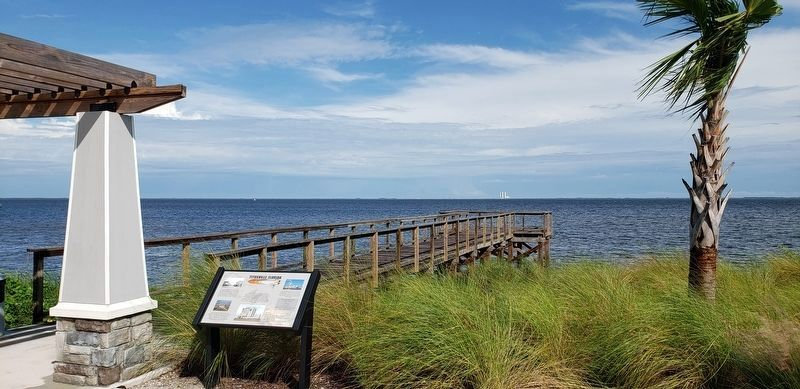 Titusville Florida Marker • <i>wide view<br>(VAB visible beyond pier • in distant background)</i> image. Click for full size.