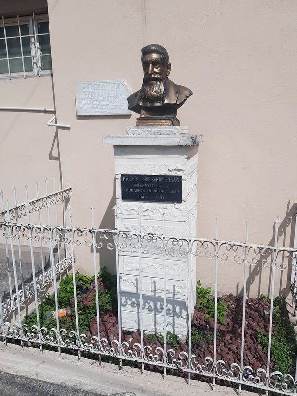 A monument to teacher Serafín Peña near the Purísima Cemetery Marker image. Click for full size.