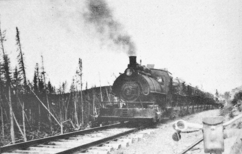 Marker detail: Arrival of train at Lac Long, circa 1910 image. Click for full size.