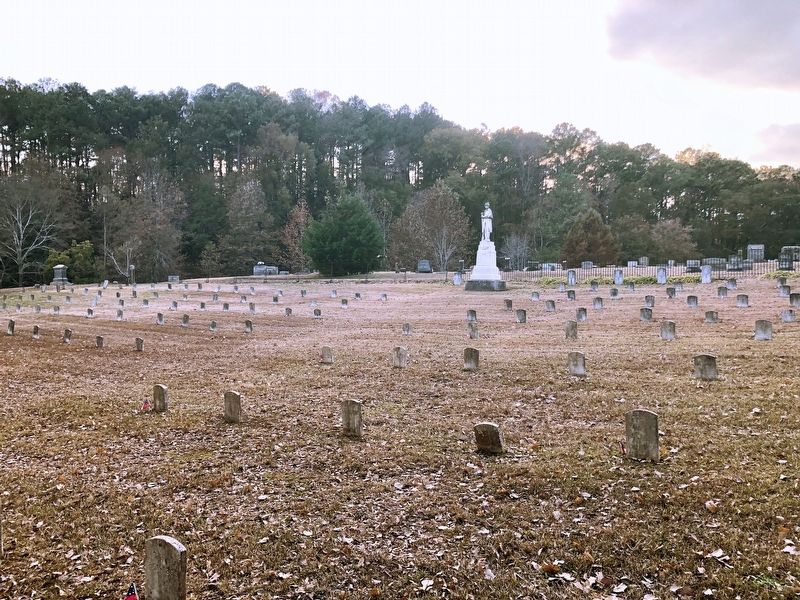 Some of the unknown solider grave markers and the Confederate Monument. image. Click for full size.