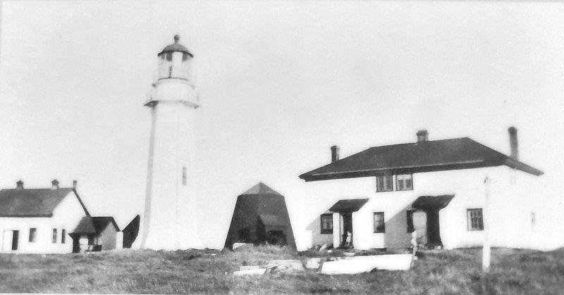 Marker detail: View of the buildings including the Foghorn Building, first built in 1909 image. Click for full size.