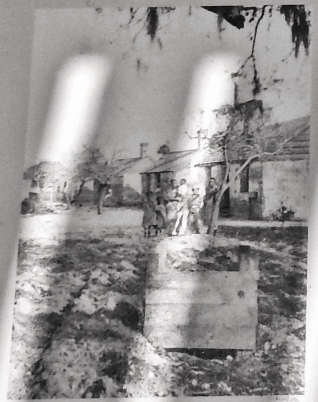 Marker detail: This post-Civil War photograph shows families still living in the cabins image. Click for full size.