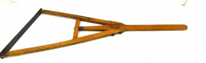 "Antique ""Lively Lad"" weed cutter"