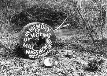 Early memorial to the Haun's Mill massacre, painted on the millstone. image. Click for full size.