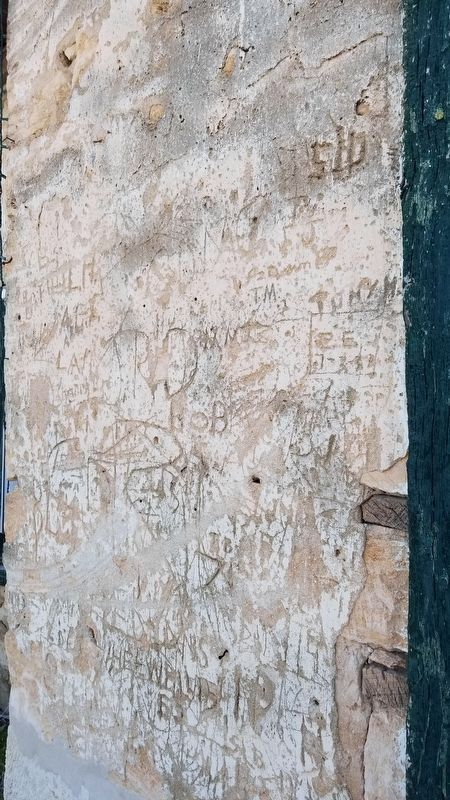 Graffiti and bullet holes at the Old Rock Store image. Click for full size.