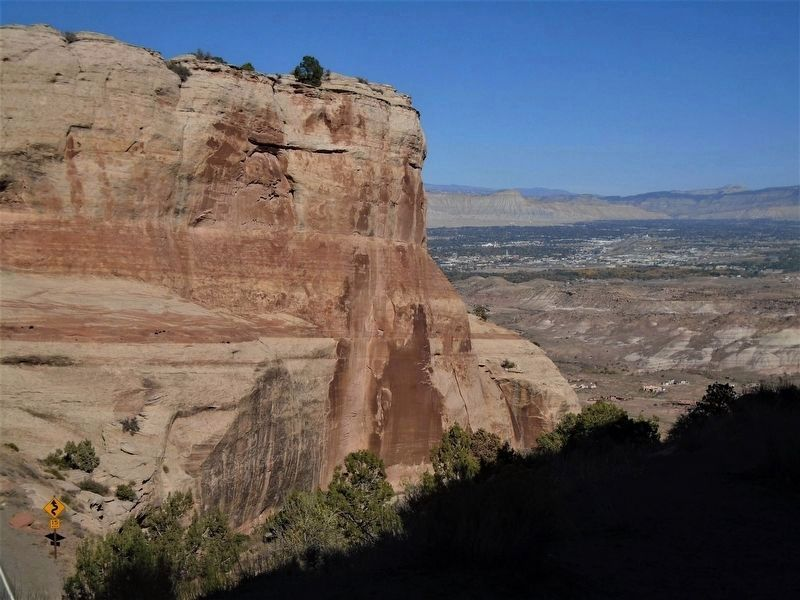 View NE toward Grand Junction from near the Upper Serpents Trail Marker image. Click for full size.