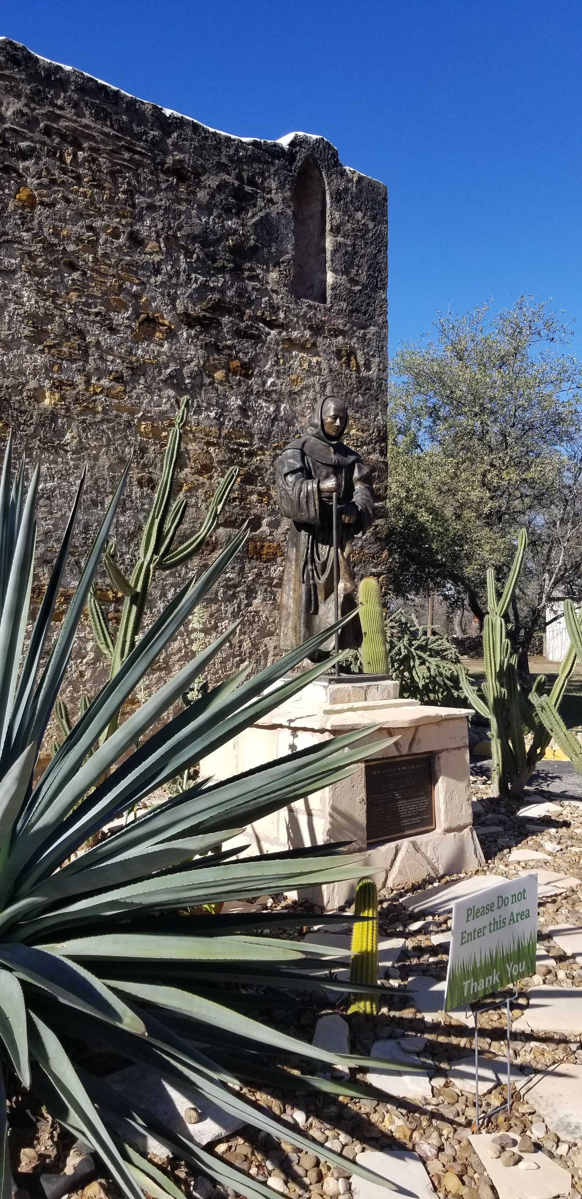 The back wall of the Mission San Jose Church and the statue