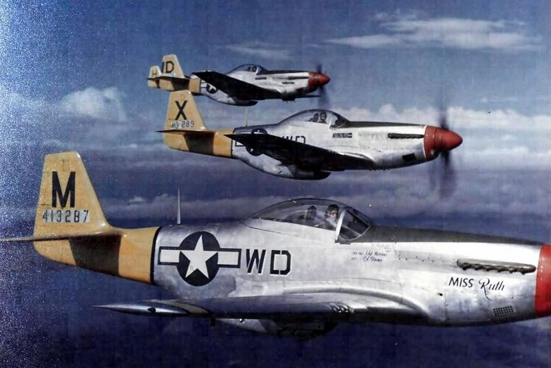 P-51D Mustangs of the 4th Fighter Squadron, 52nd Fighter Group image. Click for full size.
