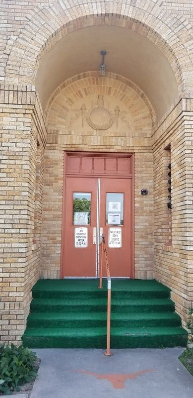 Doorway of Buell School with relief work over the entry image. Click for full size.