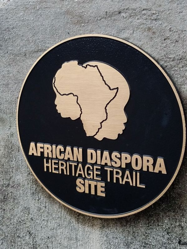 Plaque designating Pilot Darrell's house as an African Diaspora Heritage Trail Site image. Click for full size.