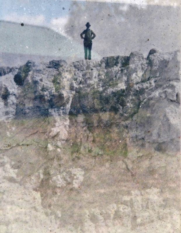 Marker detail: Man standing atop the edge of a limestone mine in nearby Suwannee County image. Click for full size.